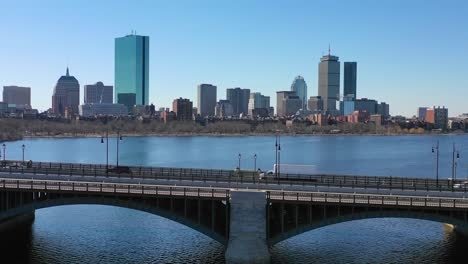Aerial-establishing-city-skyline-of-Boston-Massachusetts-with-Longfellow-bridge-and-vehicle-traffic-crossing