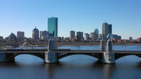 Aerial-establishing-city-skyline-of-Boston-Massachusetts-with-Longfellow-bridge-and-subway-train-crossing-1