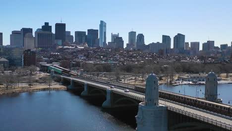 Aerial-establishing-city-skyline-of-Boston-Massachusetts-with-Longfellow-bridge-and-subway-train-crossing-3