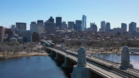 Aerial-establishing-city-skyline-of-Boston-Massachusetts-with-Longfellow-bridge-and-subway-train-crossing-4