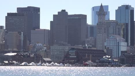 Establishing-skyline-of-Boston-Massachusetts-with-sparkling-waterfront-in-foreground