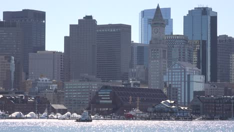 A-water-taxi-moves-in-front-of-the-downtown-city-skyline-and-financial-district-of-Boston-Massachusetts-1