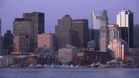 Skyline-of-downtown-Boston-Massachusetts-with-water-taxi-at-night-or-dusk-1