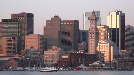 Skyline-of-downtown-Boston-Massachusetts-with-water-taxi-at-sunset-or-sunrise