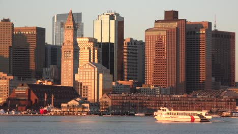 Skyline-of-downtown-Boston-Massachusetts-with-water-taxi-at-sunset-or-sunrise-2