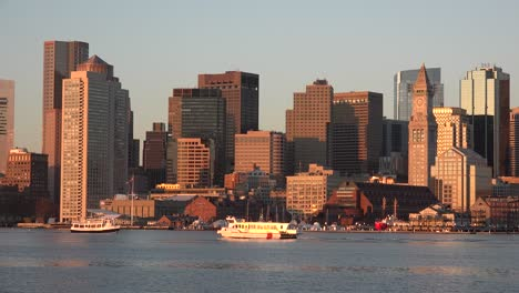 Skyline-of-downtown-Boston-Massachusetts-with-water-taxi-at-sunset-or-sunrise-3