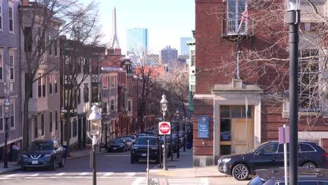 Establishing-shot-of-apartments-and-streets-on-Bunker-Hill-Boston-Massachusetts-with-Leonard-P-Zakim-Bunker-Hill-Memorial-Bridge-background-2