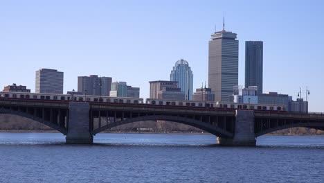 Establishing-city-skyline-of-Boston-Massachusetts-with-Longfellow-bridge-and-subway-train-crossing