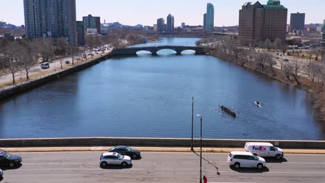 Aerial-over-bridges-on-the-Charles-River-near-Harvard-University-campus-with-scullers-crew-rowing-on-the-river