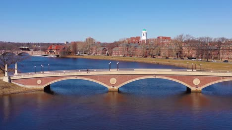 Aerial-over-the-John-W-Weeks-Footbridge-reveals-Harvard-University-campus-on-the-Charles-River-1
