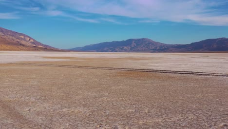 Nice-low-aerial-over-Death-Valley-National-Park-and-a-vast-open-desert-playa