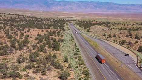 Aerial-over-a-truck-traveling-on-highway-395-to-reveal-the-Owens-Valley-and-the-Eastern-Sierra-Nevada-mountains-of-California