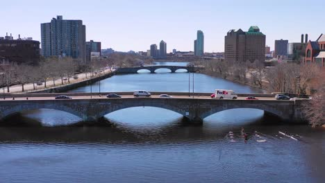 Aerial-over-bridges-on-the-Charles-River-near-Harvard-University-campus-with-scullers-crew-rowing-on-the-river-1