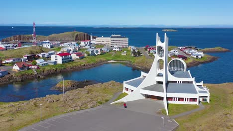 Aerial-over-a-modernist-Christian-church-in-stykkisholmur-Iceland-1