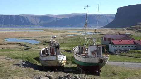 Abandoned-fishing-boats-sit-on-the-land-in-a-remote-fjord-in-Iceland-as-the-cod-industry-declines-2