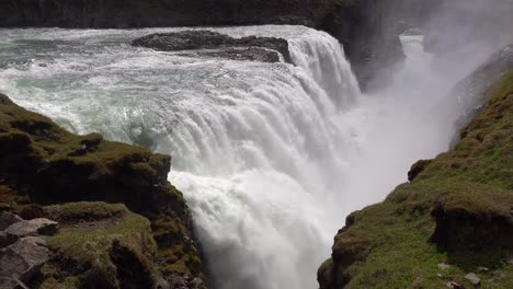 Pan-across-the-massive-Gulfoss-waterfall-flowing-in-Iceland