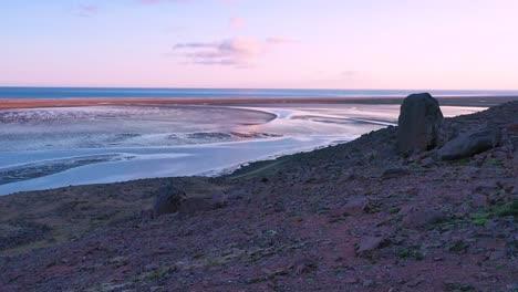 Aerial-shot-of-tidal-bay-and-sunset-patterns-near-Rau______isandur-Beach-Westfjords-Iceland
