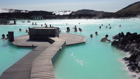 Establishing-of-bathers-enjoying-the-famous-Blue-Lagoon-geothermal-hot-water-spa-and-bath-in-Grindavik-Iceland-1