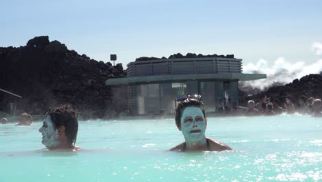 Establishing-of-bathers-with-mud-facials-in-the-famous-Blue-Lagoon-geothermal-hot-water-spa-and-bath-in-Grindavik-Iceland-2