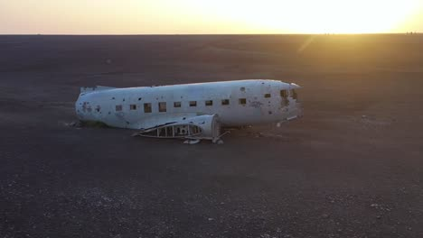 Aerial-over-a-crashed-US-Navy-DC-3-on-the-black-sands-of-Solheimasandur-Iceland-1