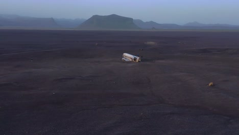 Aerial-over-a-crashed-US-Navy-DC-3-on-the-black-sands-of-Solheimasandur-Iceland-4
