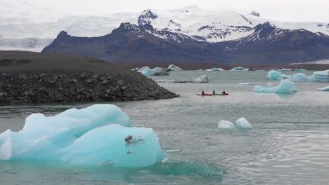 Kayakers-move-through-a-melting-glacier-lagoon-at-Jokulsarlon-Iceland