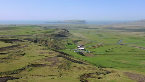 Beautiful-aerial-over-typical-Iceland-landscape-near-Vik-includes-volcanic-and-ocean-landscapes
