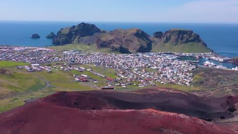 Good-vista-aérea-of-Eldfell-volcano-looming-over-Heimaey-in-the-Westman-Islands-Vestmannaeyjar-Iceland-6