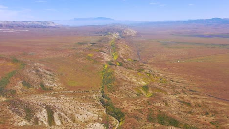 Very-good-aerial-of-the-San-Andreas-Fault-earthquake-faultline-running-through-the-Carrizo-Plain-of-California