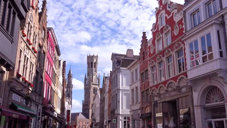 Establishing-shot-of-apartments-and-homes-in-Bruges-Belgium-with-cobblestone-street-3