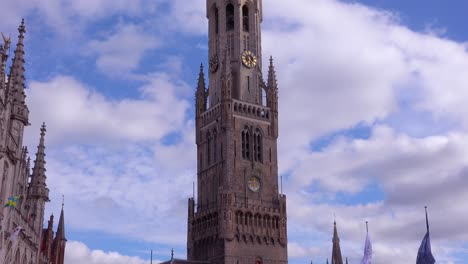 Tilt-up-from-central-square-to-the-Belfort-Van-Brugge-Bruges-belfry-bell-tower-in-Belgium