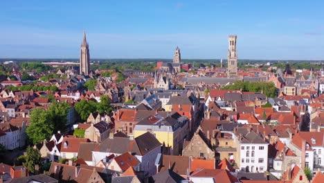Pretty-establishing-aerial-of-the-skyline-of-Bruges-Belgium-includes-Belfort-Van-Brugge-and-other-landmarks