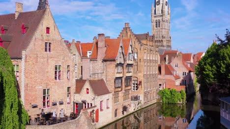 Good-rising-aerial-reveal-the-skyline-of-Bruges-Belgium-includes-Belfort-Van-Brugge-and-other-downtown-landmarks