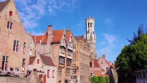 Canal-aerial-reveal-the-skyline-of-Bruges-Belgium-includes-Belfort-Van-Brugge