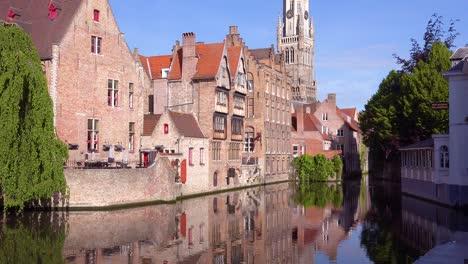 Beautiful-canal-and-the-Belfort-Van-Brugge-Bruges-belfry-bell-tower-in-Belgium