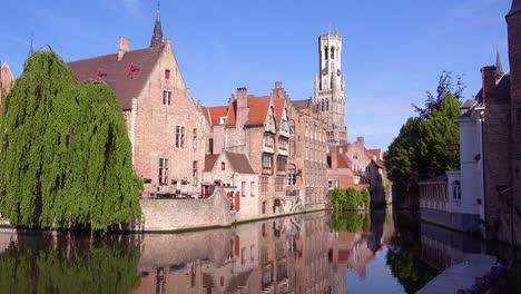 Beautiful-canal-and-the-Belfort-Van-Brugge-Bruges-belfry-bell-tower-in-Belgium-1