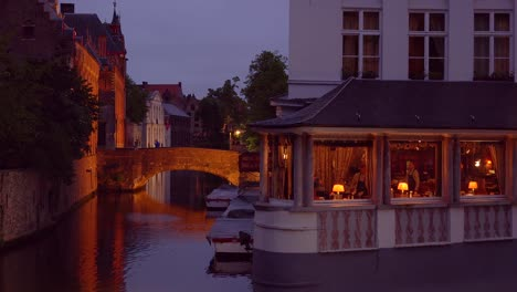 An-elegant-fancy-restaurant-along-a-beautiful-canal-in-Europe-Bruges-Belgium-night