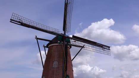 Nice-time-lapse-shot-of-a-Dutch-Holland-windmill-with-clouds-behind