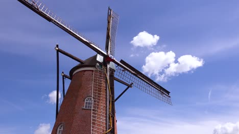 Nice-time-lapse-shot-of-a-Dutch-Holland-windmill-with-clouds-behind-1
