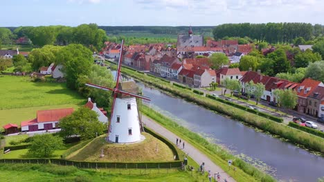 Aerial-over-canal-and-small-town-of-Damme-Belgium-and-historic-windmill-3