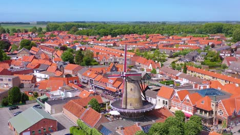 Aerial-over-classic-Dutch-Holland-town-with-prominent-windmill-Sluis-Netherlands-2