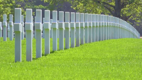 Graves-and-crosses-at-American-World-War-Two-cemetery-memorial-at-Omaha-Beach-Normandy-France-3