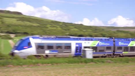 A-high-speed-electric-passenger-train-passes-through-the-countryside-of-Normandy-France