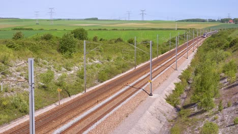 A-high-speed-electric-passenger-train-passes-through-the-countryside-of-Normandy-France-1