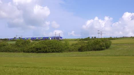 A-high-speed-electric-local-passenger-train-passes-through-the-countryside-of-Normandy-France