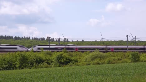 A-high-speed-electric-passenger-train-passes-through-the-countryside-of-Normandy-France-2