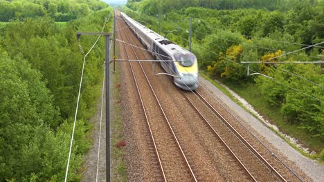 A-high-speed-electric-passenger-train-passes-through-the-countryside-of-Normandy-France-3
