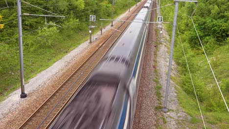 A-high-speed-electric-passenger-train-passes-through-the-countryside-of-Normandy-France-4