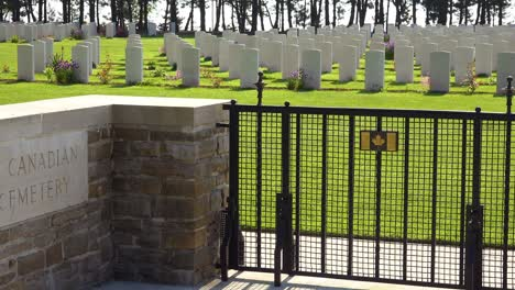 Graves-and-crosses-at-Calais-Canadian-World-War-Two-cemetery-memorial-near-Omaha-Beach-Normandy-France