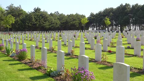 Graves-and-crosses-at-Calais-Canadian-World-War-Two-cemetery-memorial-near-Omaha-Beach-Normandy-France-2